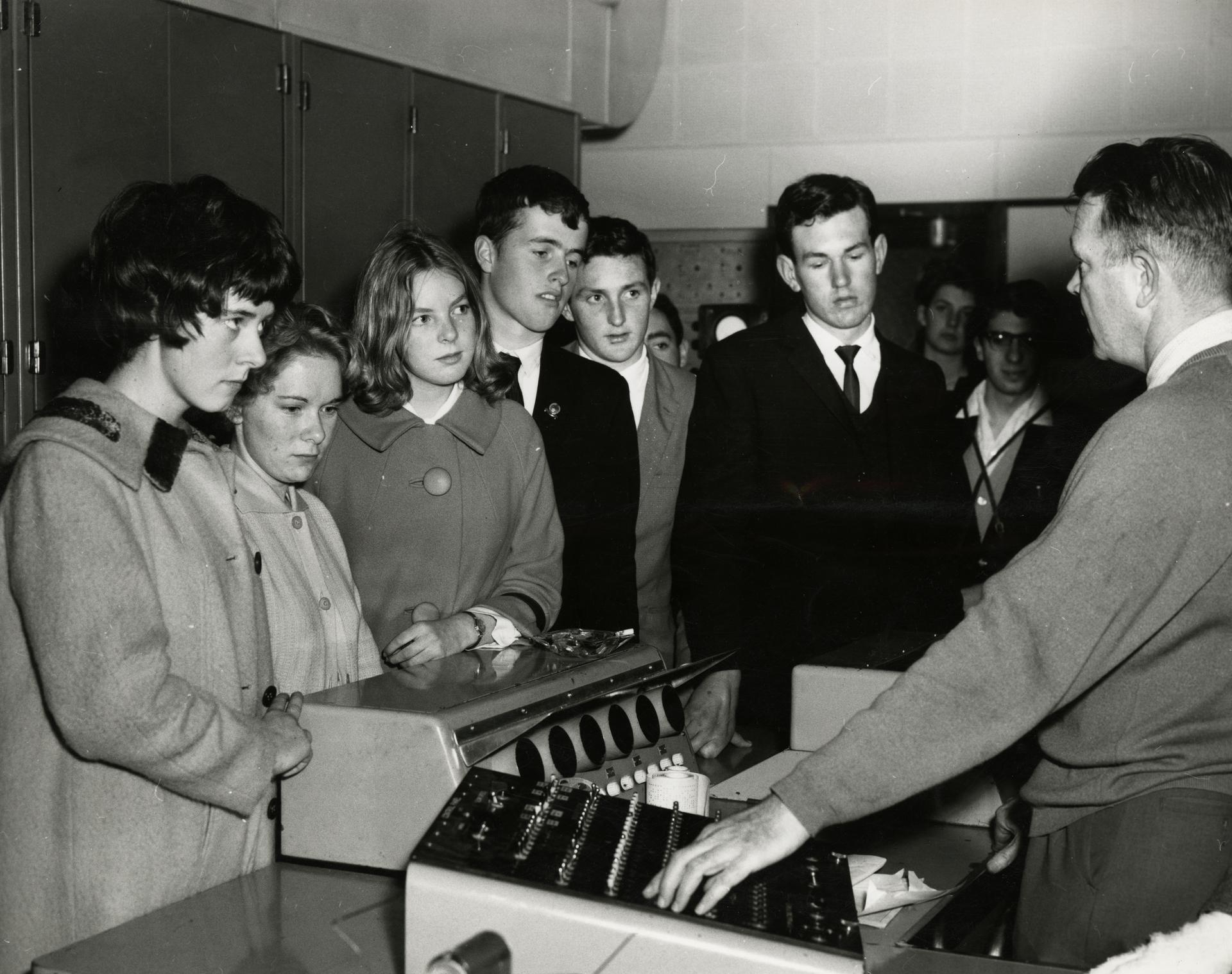 Secondary School students examine computer equipment, Open day 1963