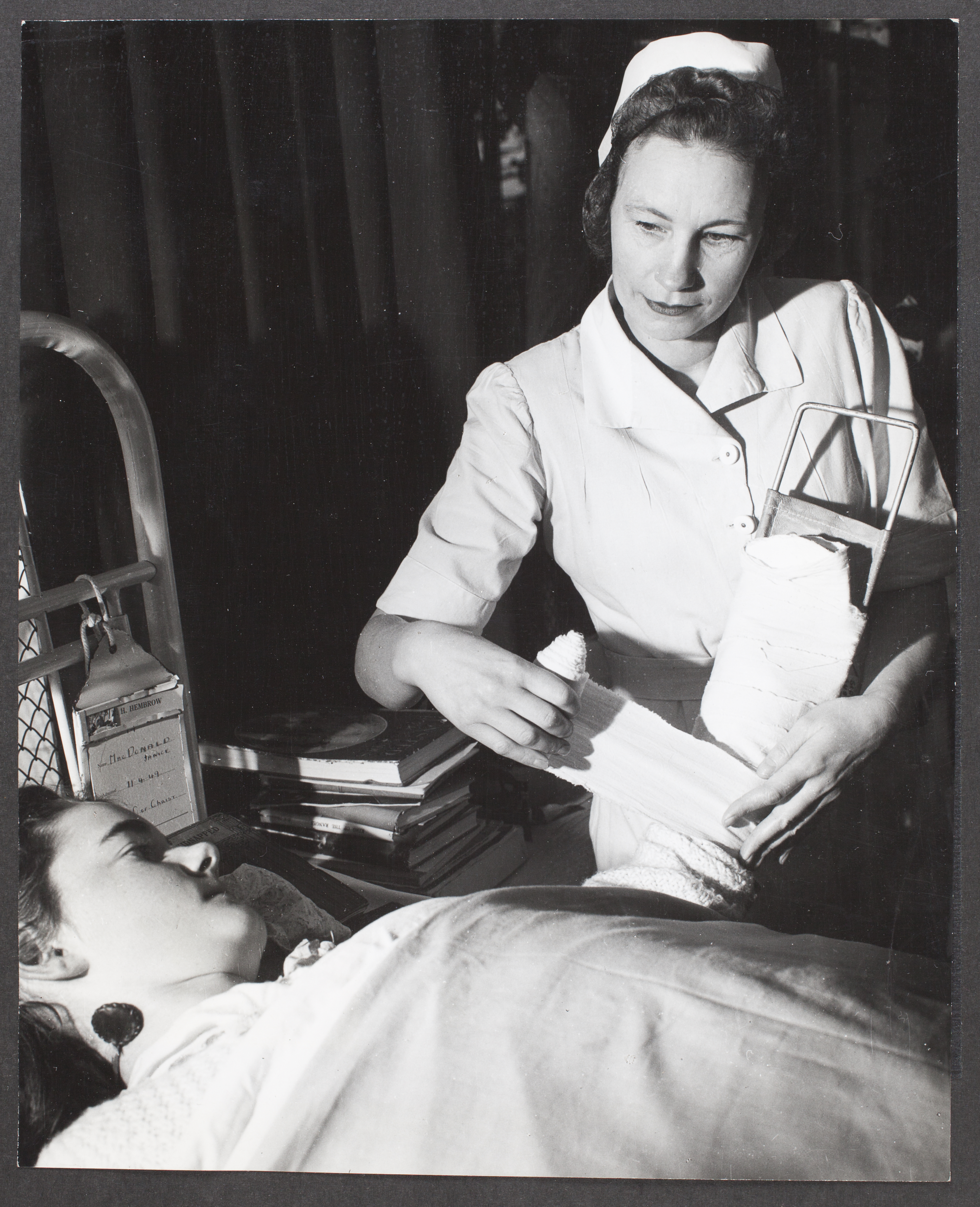 "John Loughlin, ""Anna Sipols, former Latvian nurse, now treats patients as a member on the nursing staff of the Austin Hospital, Melbourne"", 26 September 1949, Commercial Travellers' Association Administrative Records and Publications, 1979.0162.03136."