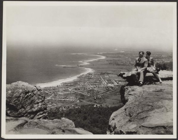 "'The finest coastal panorama in Australia. The trip is made from Sydney via Bulli Pass along Lady Carrington with big trees, palms, tree ferns, Christmas bush and other attractive flora'. ""Sublime Point, Bulli, NSW"", 17 August 1932, Commercial Travellers' Association Administrative Records and Publications, 1979.0162.02305."