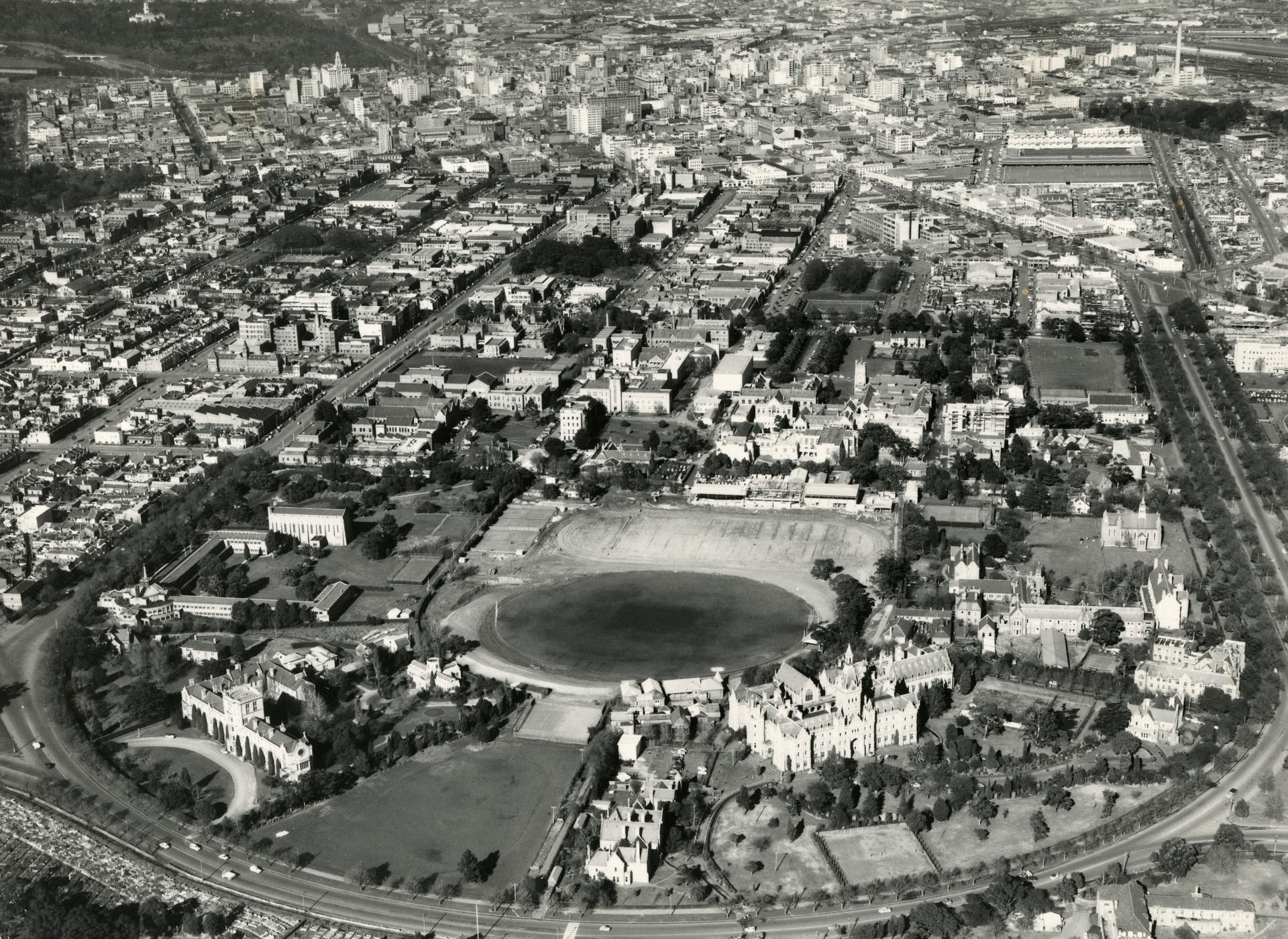 Aerial view showing beyond the main oval, c1956