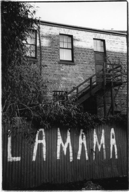La Mama painted on fence outside La Mama theatre