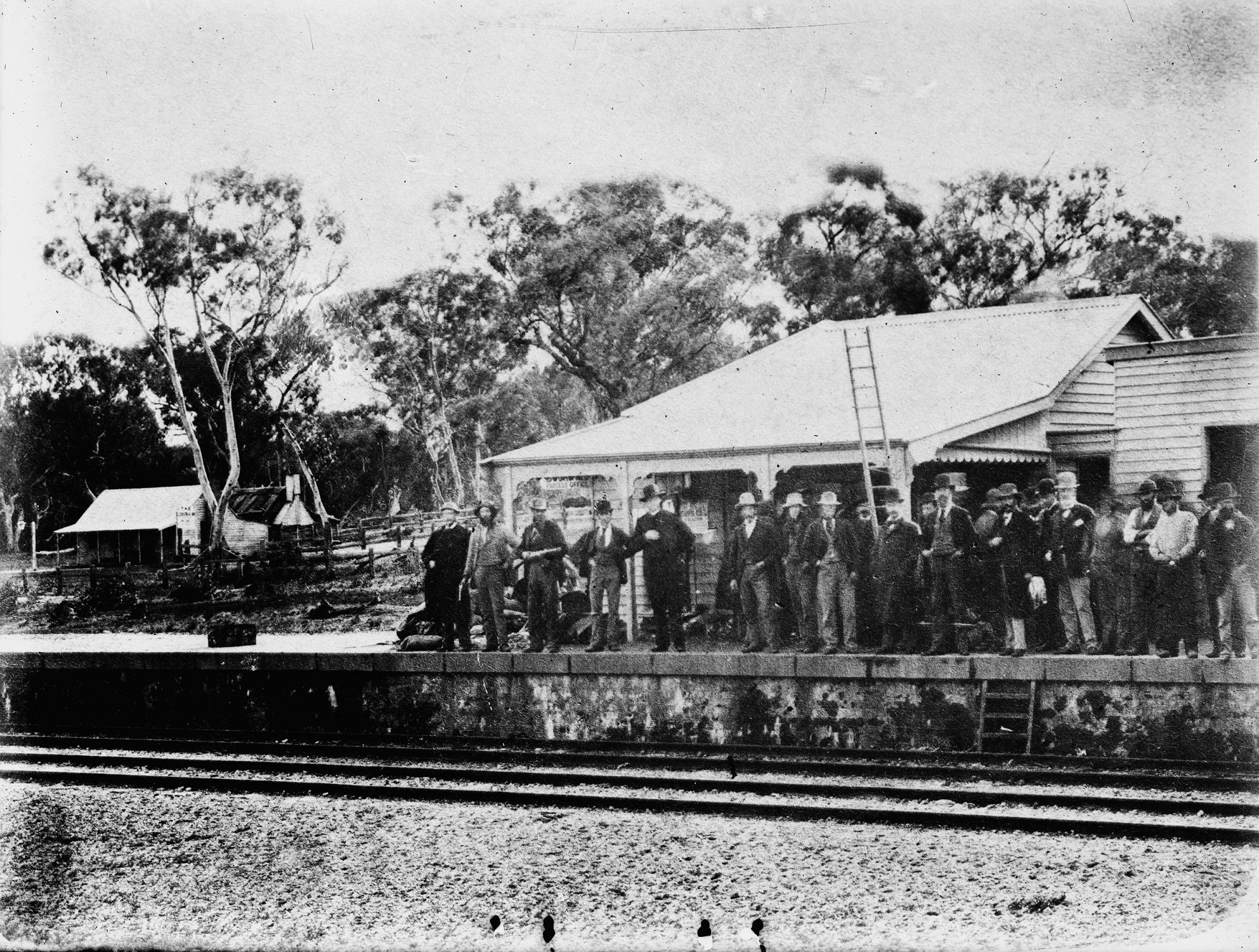 Group of men standing on Glenrowen Railway station platform