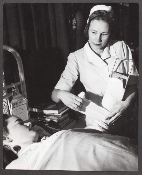 Anna Sipols, former Latvian nurse, now treats patients as a member on the nursing staff of the Austin Hospital, Melbourne, 1949. University of Melbourne Archives Commercial Travellers' Association collection 1979.0162.03136