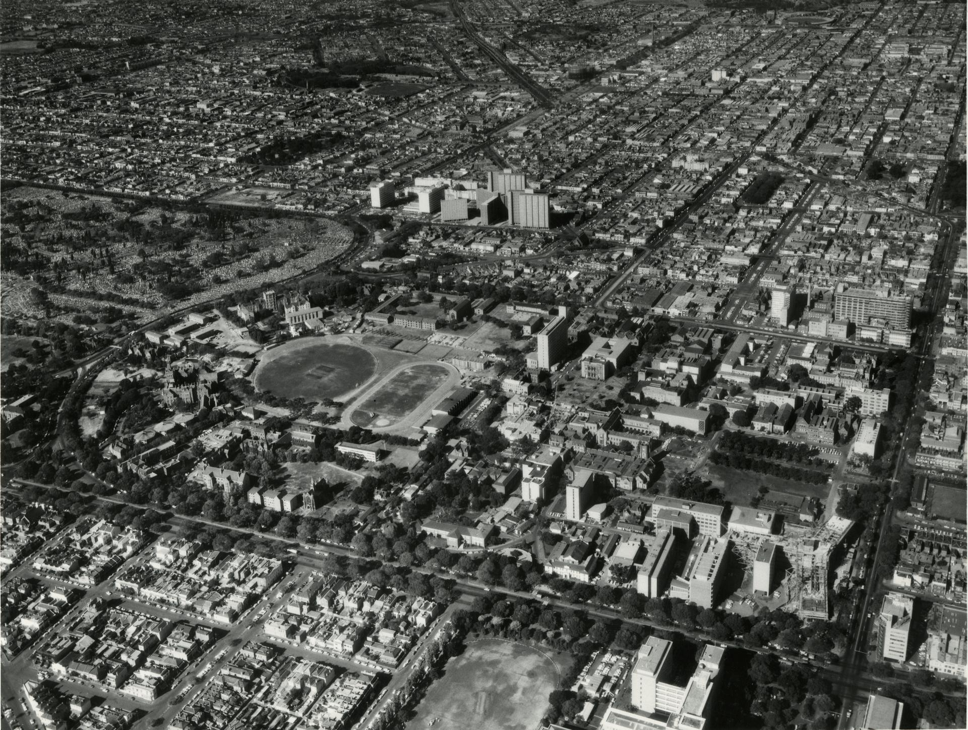 Aerial view showing the Medical precinct building in stages of completion, 1960s